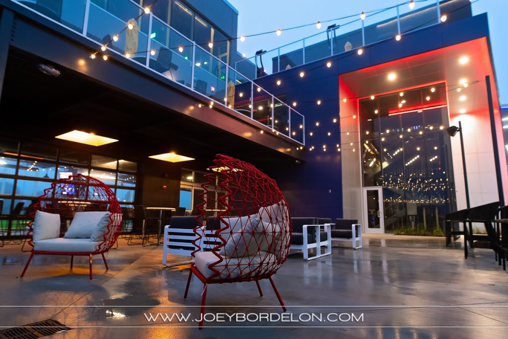 The exterior seating/lounge area of Top Golf Baton Rouge